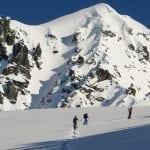 Skiers approach Peak 8100